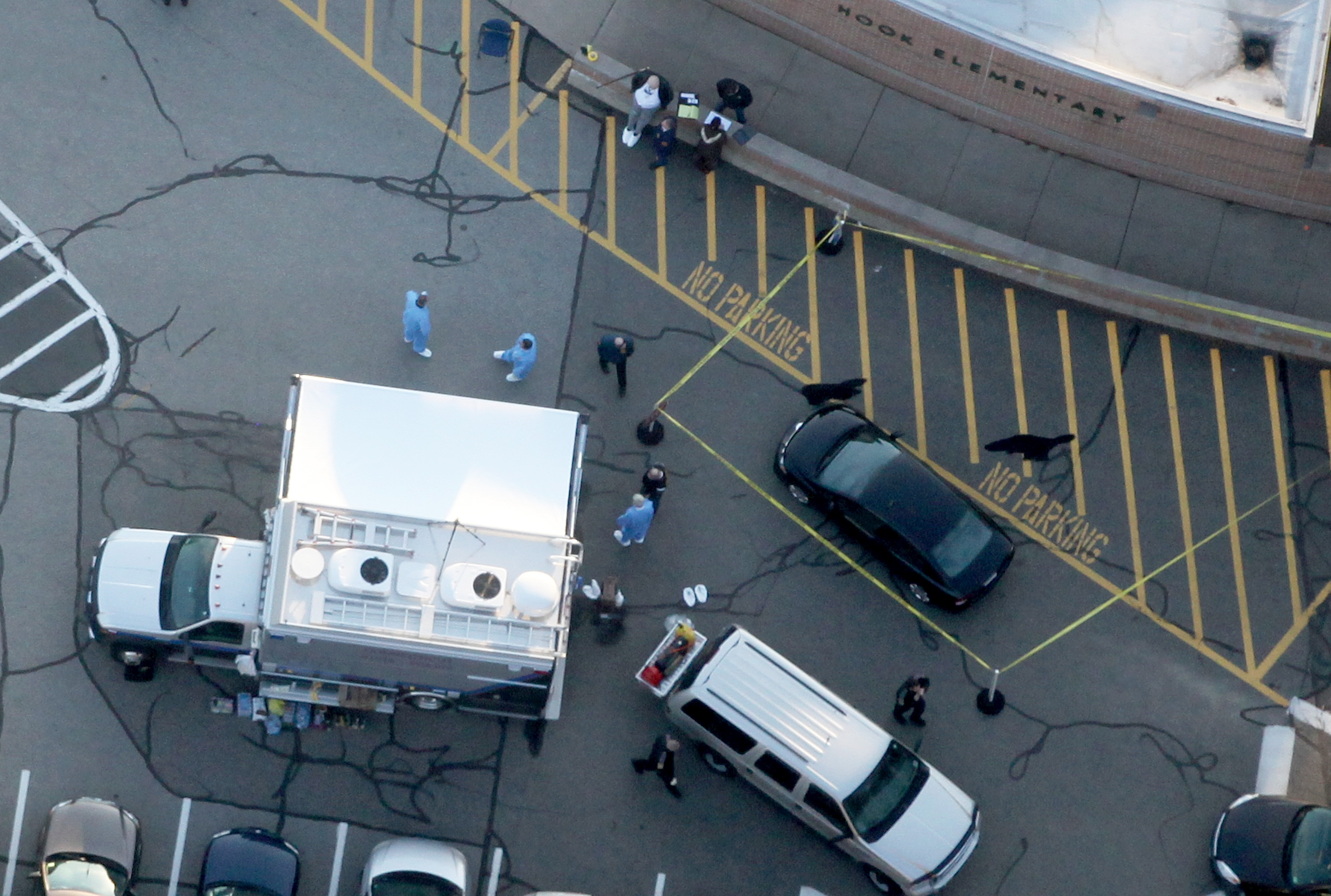 An aerial shot of the school parking lot and the black Honda allegedly driven by Adam Lanza.